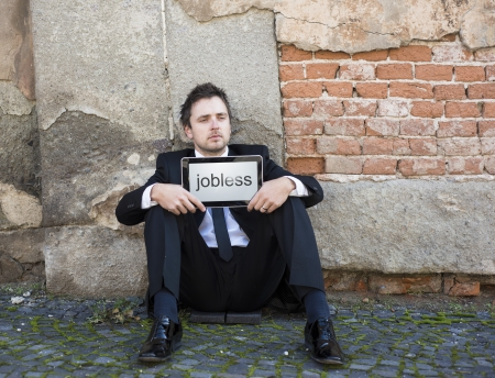 Jobless manager is on the street. photo