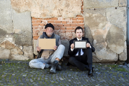 Homeless men are begging on the street. photo
