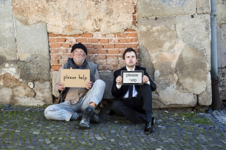 Homeless men are begging on the street. Stock Photo - 16436870