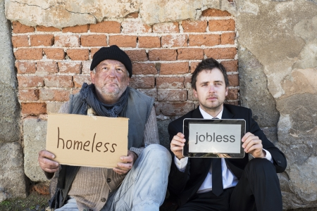 poor people: Homeless men are begging on the street.