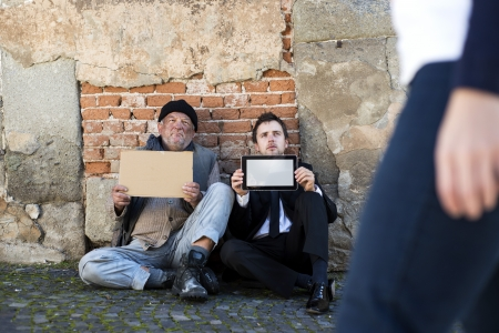 Homeless men are begging on the street. Stock Photo - 16436955