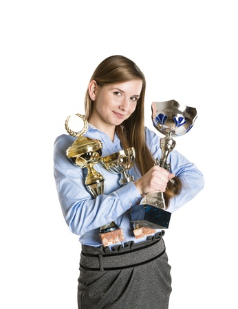 Portrait of successful business woman with trophy. photo