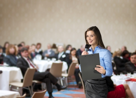 Beautiful business woman is speaking on conference. Stock Photo