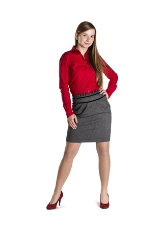 Successful business woman is standing on isolated background. photo