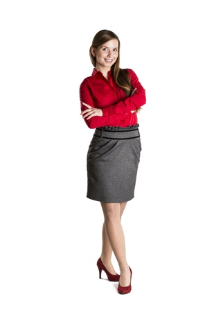 woman standing: Successful business woman is standing on isolated background.