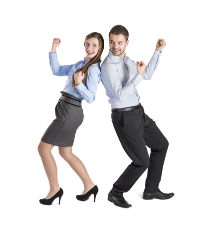 Successful business couple is standing on isolated background. Stock Photo - 16521894