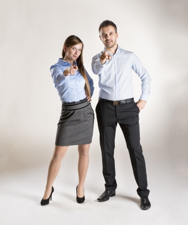attractive businesswoman: Successful business couple is standing on isolated background.
