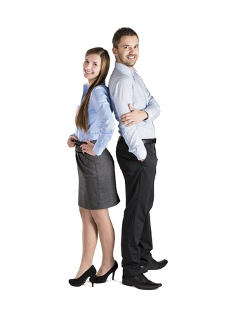 business partner: Successful business couple is standing on isolated background.