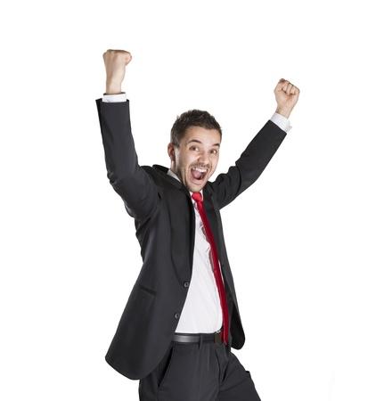 manos levantadas: Exitoso hombre de negocios está celebrando en el fondo blanco aislado