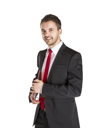 Successful business man is standing on isolated white background Stock Photo - 16569715