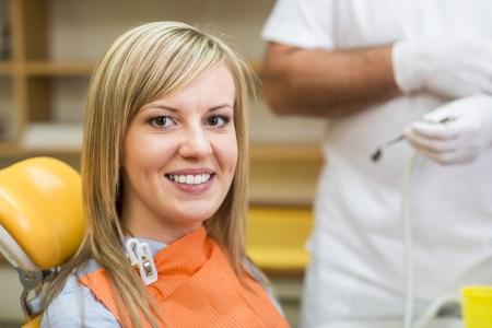 procedures: Dentist is doing treatment procedures in dental office.