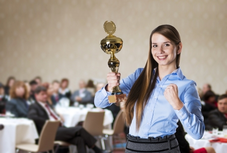 Young business woman was awarded on corporate conference  photo