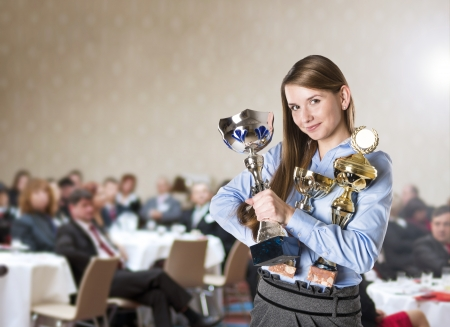 prize: Young business woman was awarded on corporate conference