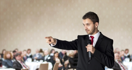 conference speaker: Man is speaking on indoor business conference for managers  Stock Photo
