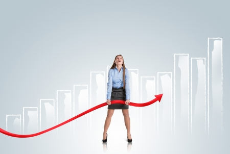 Business woman is trying to increase market statistics. Stock Photo