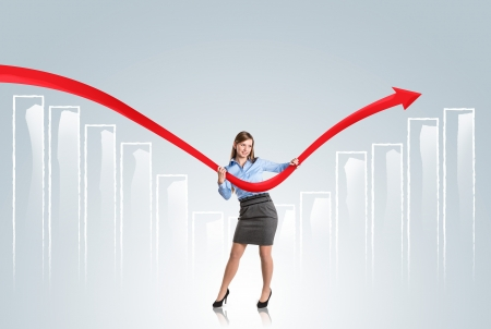 Business woman is trying to increase market statistics. Stock Photo - 16615300