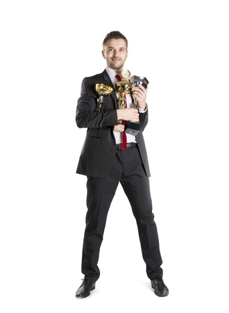 Successful business man is celebrating success on isolated white background photo