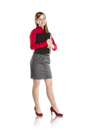 full lenght: Successful business woman is standing with file folder on isolated background Stock Photo