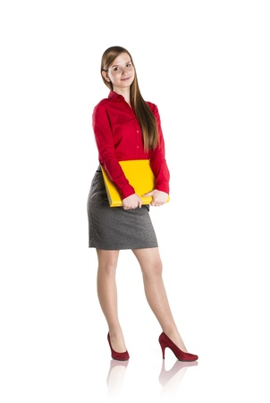 Successful business woman is standing with file folder on isolated background Stock Photo - 16715487