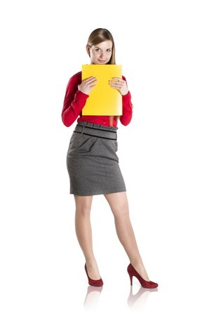 Successful business woman is standing with file folder on isolated background Stock Photo - 16715485