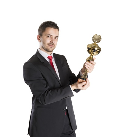 trophy winner: Successful business man is celebrating success on isolated white background