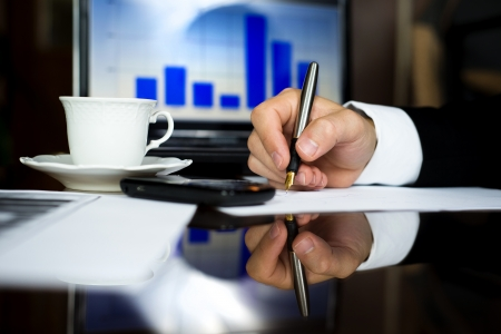 Businessman is working on analysis in his office Stock Photo - 16847187