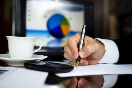Businnessman is making analysis before meeting Stock Photo - 16873847