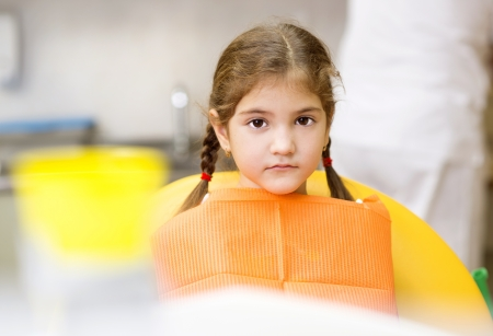 Little girl is having her teeth checked by dentist Stock Photo - 17109613