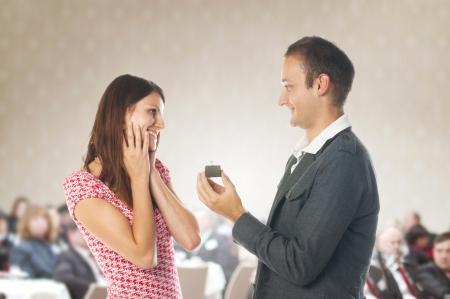 Romantic proposal scene with happy woman and man  Stock Photo - 17109598