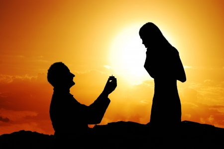 Romantic proposal scene with happy woman and man  photo