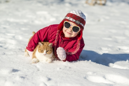 Little girl is playing outside in cold winter  photo