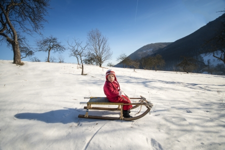 Little girl is playing outside in cold winter Stock Photo - 17219395