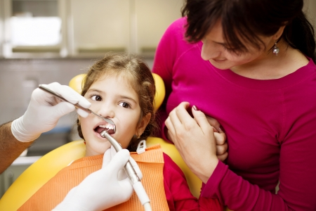 Little girl is having her teeth checked by dentist Stock Photo - 17458117