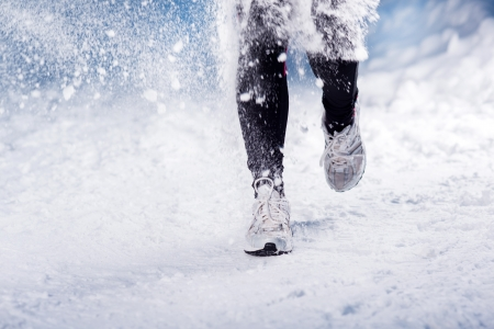 winter woman: Athlete woman is running during winter training outside in cold snow weather  Stock Photo