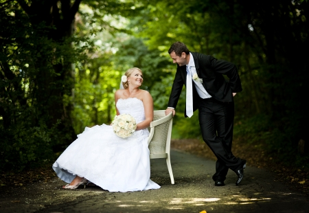 wedding chairs: Bride and groom outdoor wedding portraits  Stock Photo