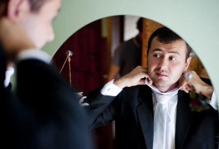 getting ready: Groom is getting ready for the wedding