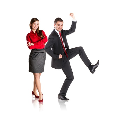 Successful business couple is standing on isolated background. photo