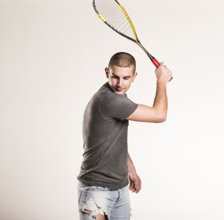 Squash player with racquet isolated on white background photo