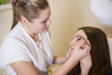 make up artist: Make up artist doing professional make up of young woman