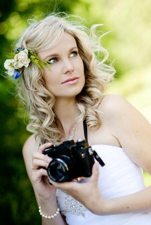 Beautiful bride is enjoying her wedding day photo