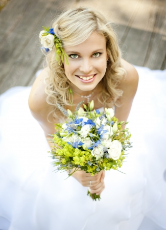 Beautiful bride is enjoying her wedding day photo