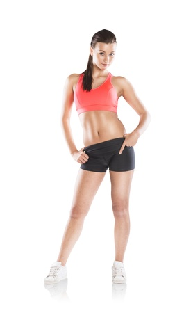 woman sport: Young woman with beautiful slim body in sport clothes.