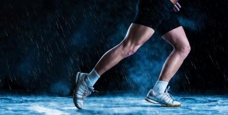 Detail of runne feet running in misty dark photo
