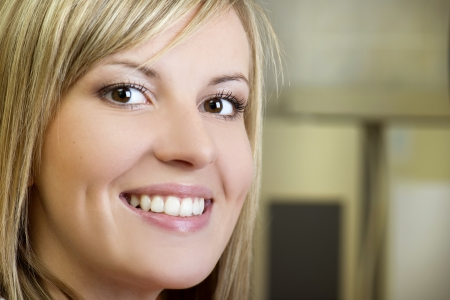 Beautiful girl is showing her white teeth at dentist photo
