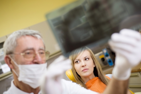 Dentist is showing the x ray of teeth to his patient Stock Photo - 18248476