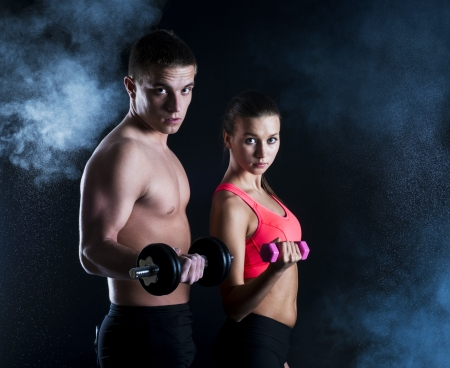Young fitness models are posing in studio Stock Photo - 18462026