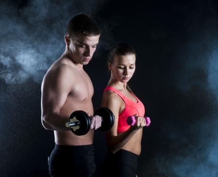 Young fitness models are posing in studio Stock Photo - 18462028