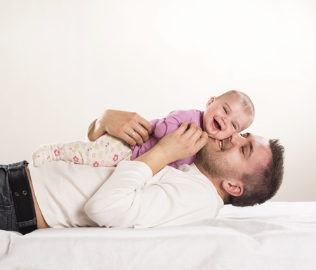 father and child: Young father is having fun with his little baby