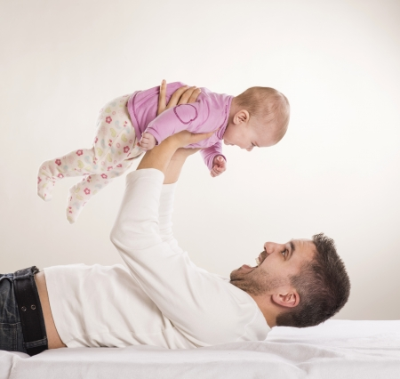 Young father is having fun with his little baby Stock Photo - 18461975