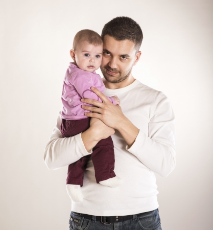 dad daughter: Young father is having fun with his little baby